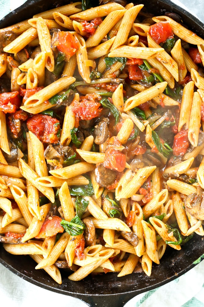 whole wheat penne with mushrooms spinach and tomatoes happy
