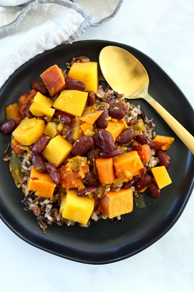 Root Vegetable and Red Bean Stew Recipe vegan recipe on black plate with rice