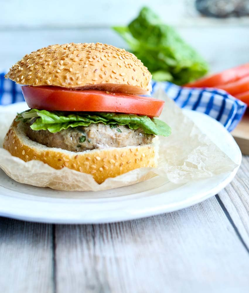 Mozzarella Stuffed Turkey Burgers with tomato and lettuce