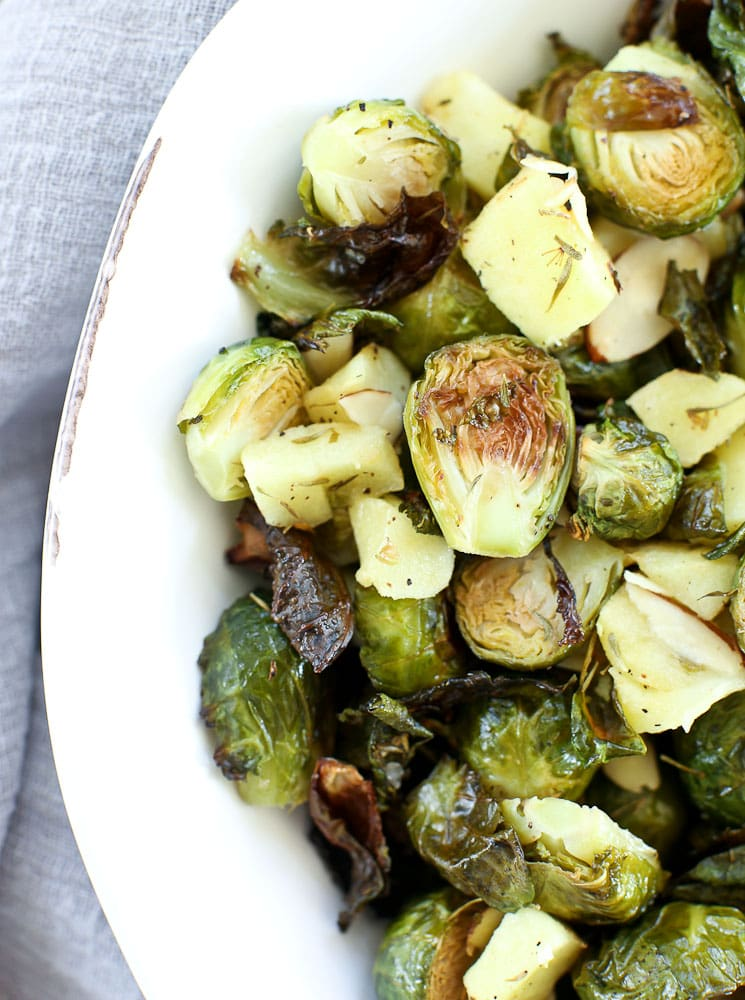 Roasted Brussels sprouts with apples and almonds in a white bowl recipe
