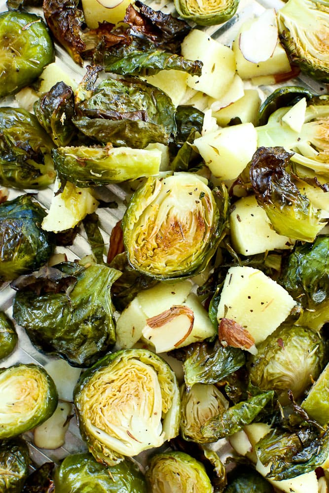 Close up of roasted brussels sprouts with apples and almonds recipe