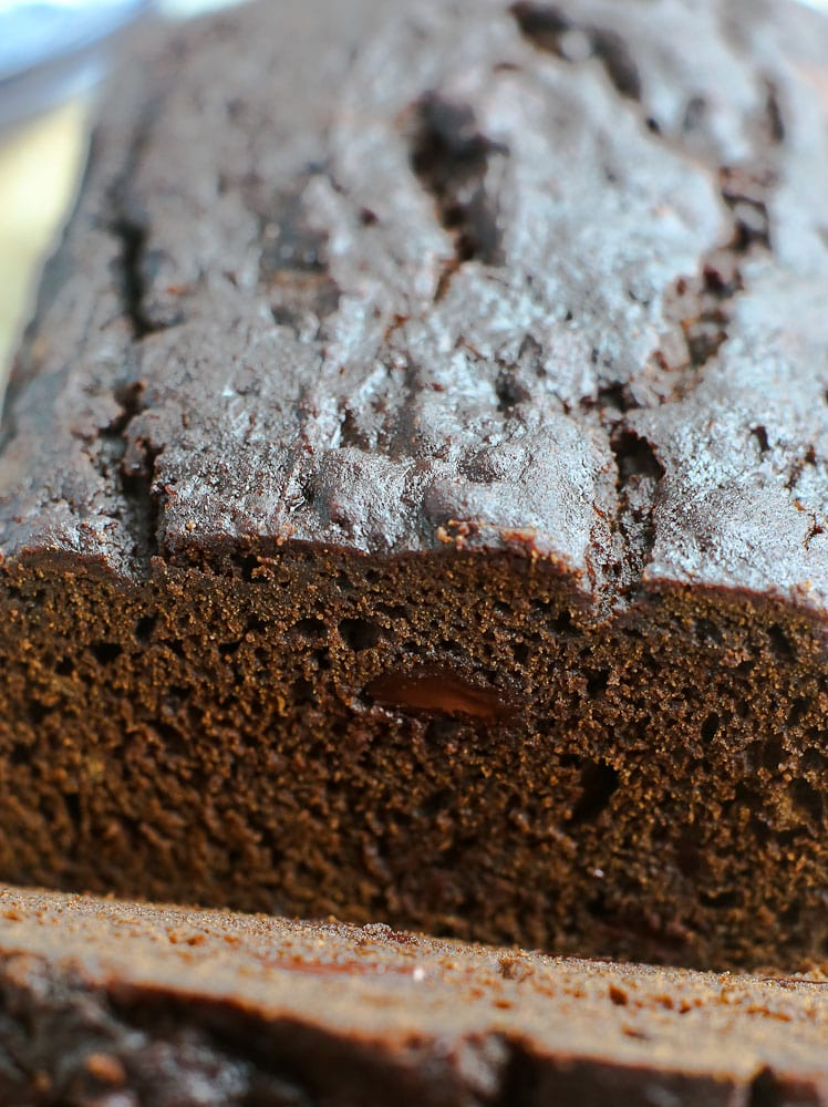 close up shot showing texture of Pumpkin Molasses Quick bRead with chocolate chips recipe