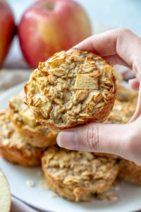 Apple Cinnamon Baked Oatmeal Cups Recipe holding one in hand