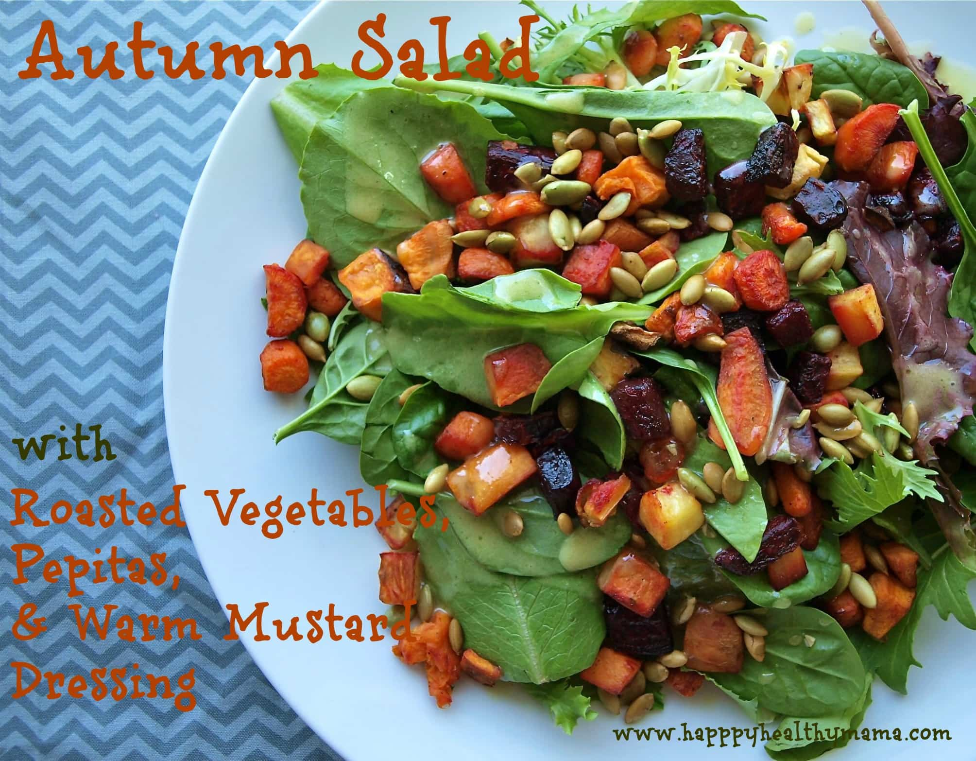 Autumn salad with roasted vegetables, pepitas, and warm mustard dressing