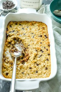 recipe for Coconut Chocolate Chip Baked Oatmeal whole pan with spoon serving