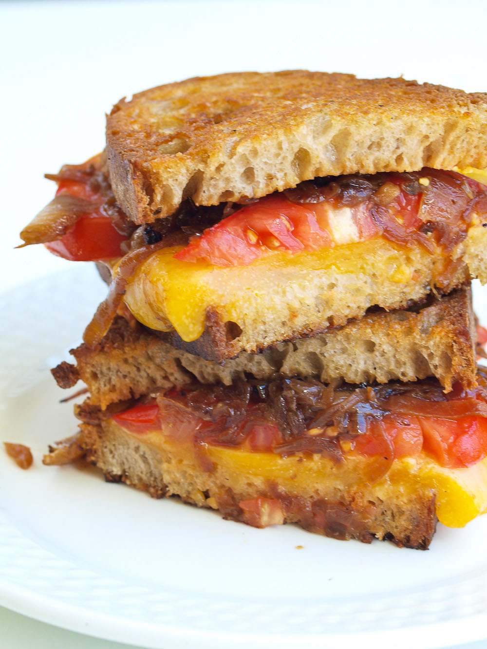 The Ultimate Grilled Cheese Sandwich with Caramelized Onions and Tomato. This is the BEST recipe for twist on the classic grilled cheese. So much better!