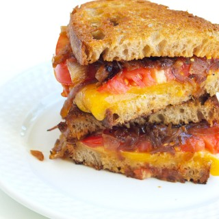 The Ultimate Grilled Cheese Sandwich with Caramelized Onions and Tomato
