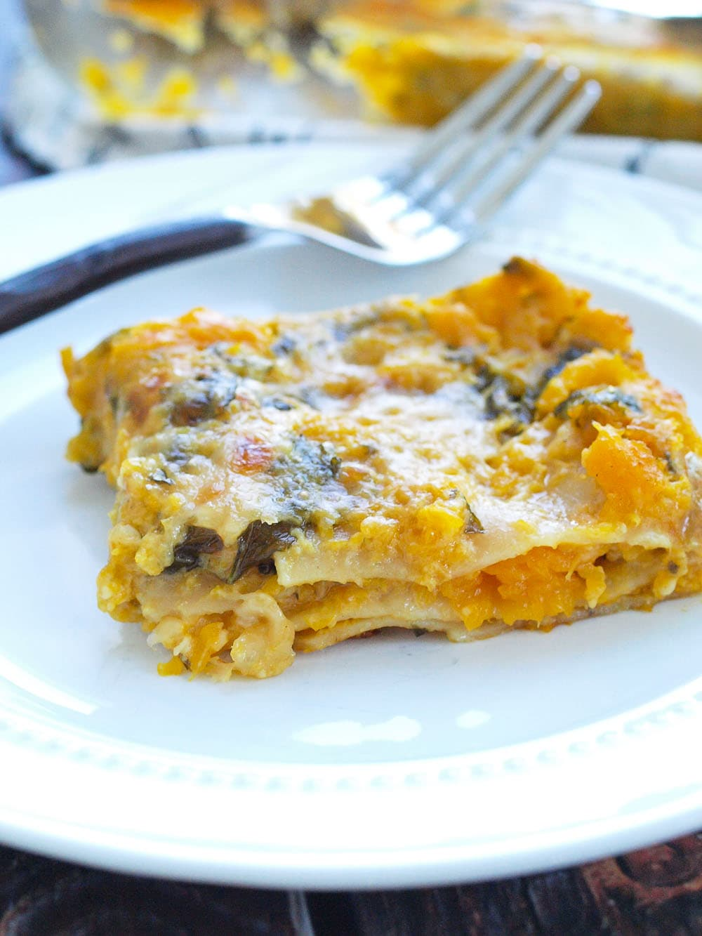 Butternut Squash and Kale Lasagna Recipe. This is the perfect fall lasagna recipe! It would make a great main-course for a vegetarian Thanksgiving, also! Love, love, love this dish!