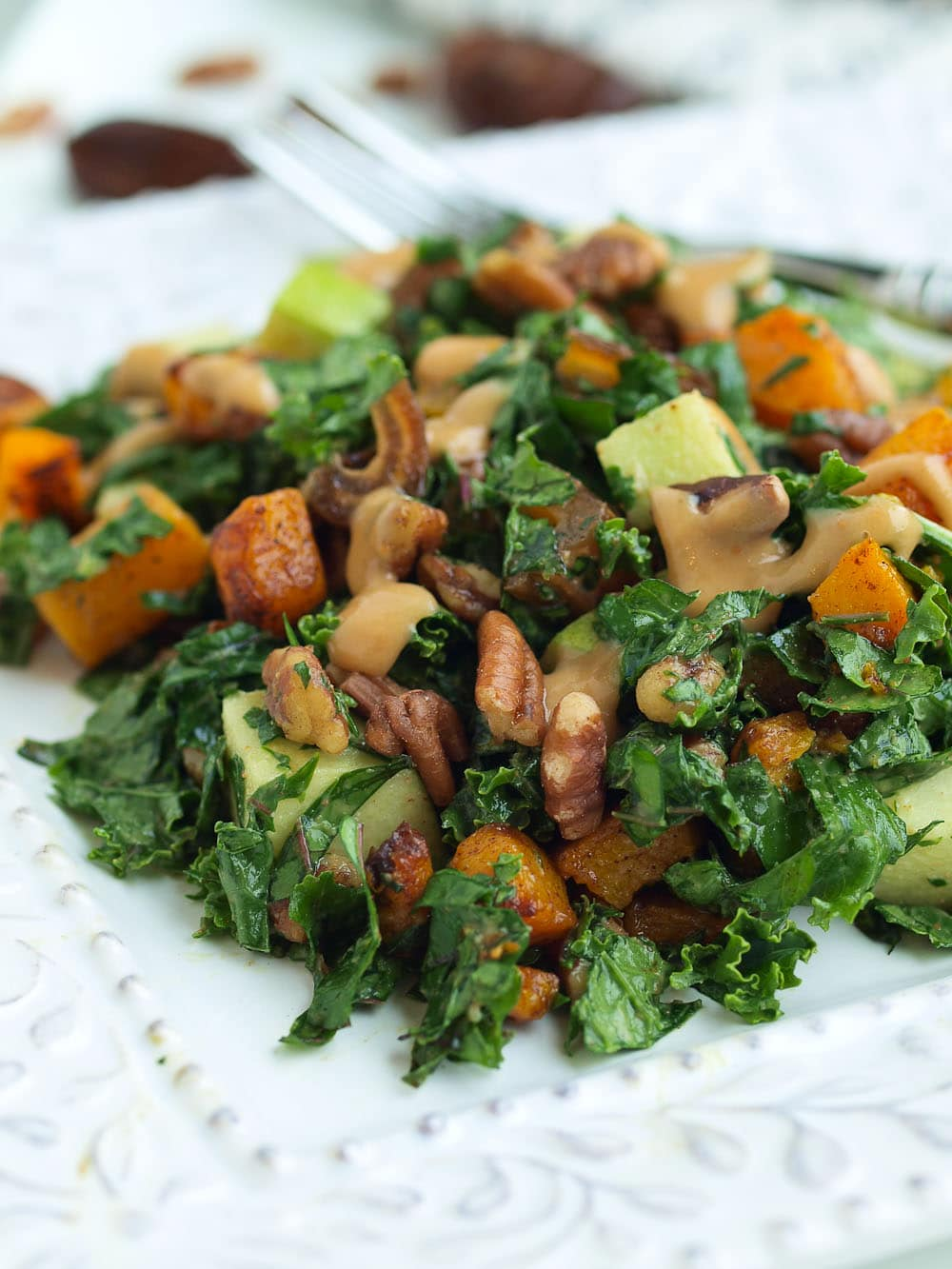 Autumn Kale Salad Recipe. This easy kale salad recipe will make your family beg them to serve them kale! The oil-free dressing is AMAZING. Gluten-free and vegan recipe.