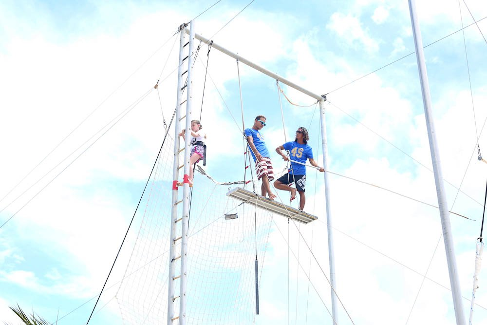 Meghan climbing the trapeze at Club Med Cancun Yucatan