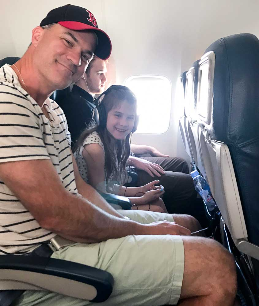 Meghan and Tim on the airplane traveling to Club Med Cancun