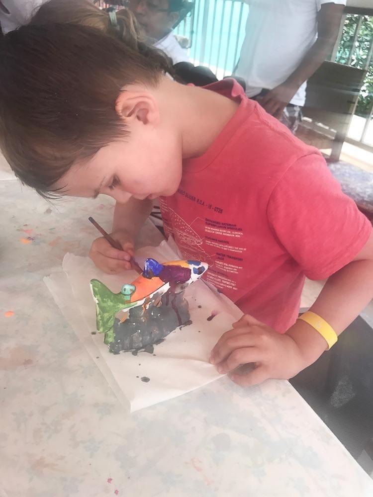 Luke painting during rain at Club Med Cancun Yucatan mexico