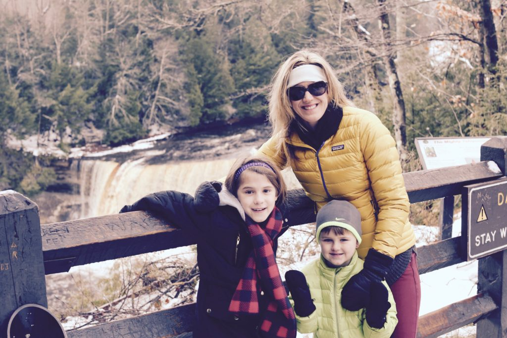 Mom with 2 kids smiling--how to not lose yourself in motherhood