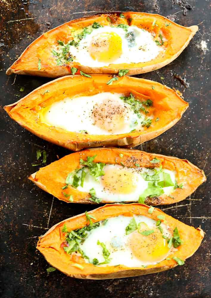 4 Baked Eggs with Spinach in a Sweet Potato Boat on a sheet pan