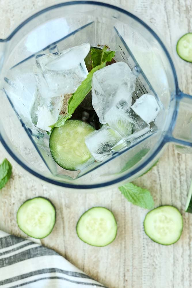 blender showing ingredients for Energizing Cucumber Mint Smoothie Recipe