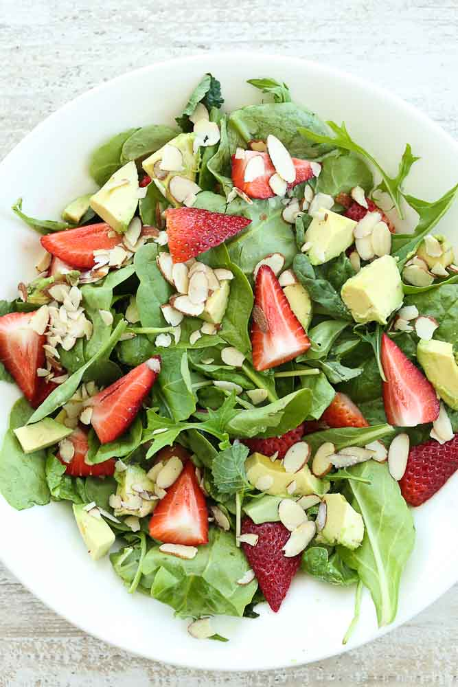 Strawberry Spinach Salad with Avocado and Strawberry Vinaigrette dressing pictured without the dressing
