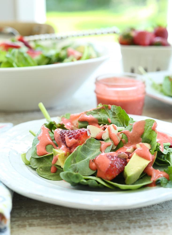 Strawberry Spinach Salad with Avocado And Strawberry Vinaigrette recipe served
