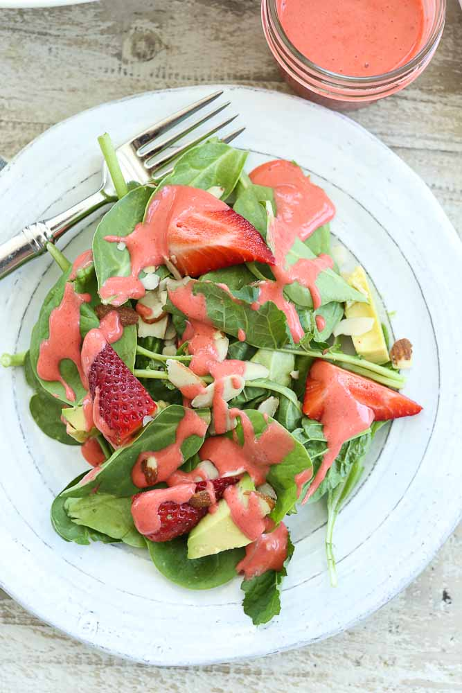 Strawberry Spinach Salad with Avocado And Strawberry Vinaigrette recipe served