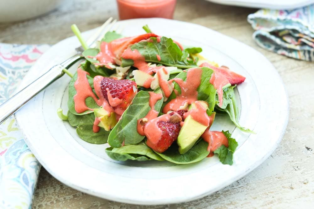 Close up picture of Spinach Strawberry Salad with Avocado and Strawberry Vinaigrette