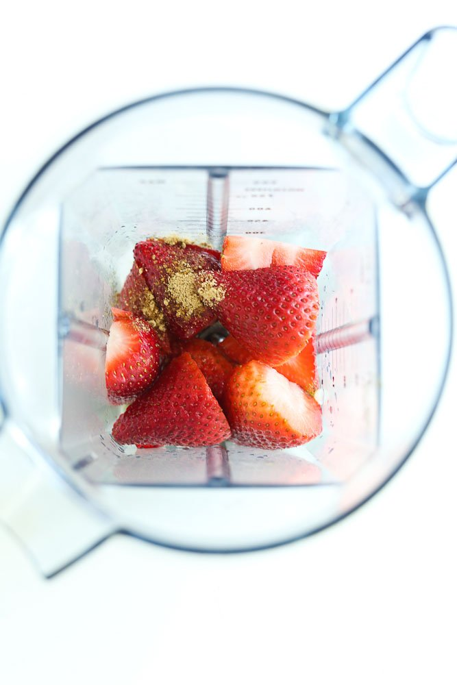 Strawberry Spinach Salad with Avocado and Strawberry Vinaigrette dressing--making the dressing with ingredients in the blender