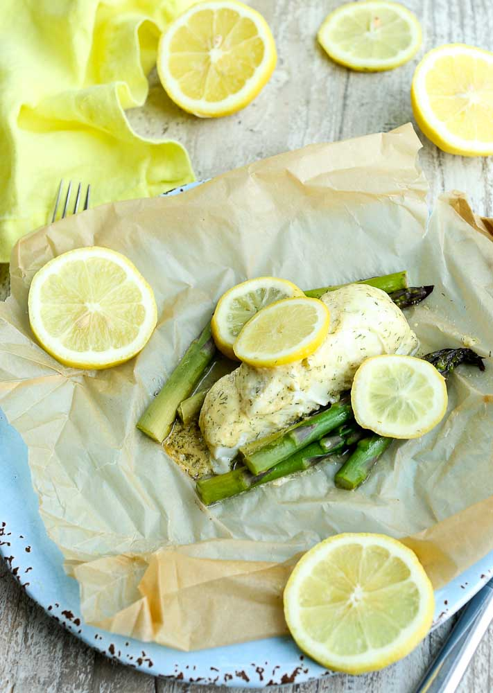 Baked Halibut in parchment with asparagus and lemon and a mustard dill sauce
