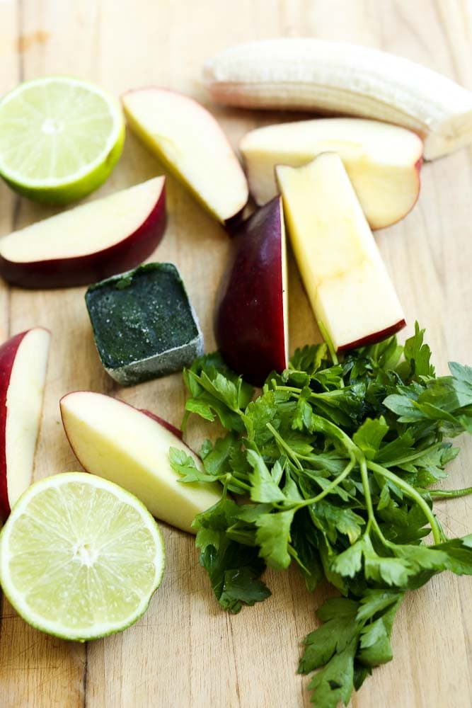 Ingredients for the Wake Me Up Green Smoothie Recipe (parsley, lime, apple, spinach cube)