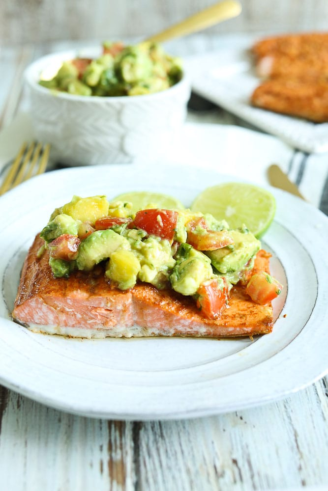 Chili Lime Baked Salmon Recipe with Pineapple Avocado Salsa on top #baked #salmon #easy #recipes #glutenfree #paleo #easy #healthyrecipes