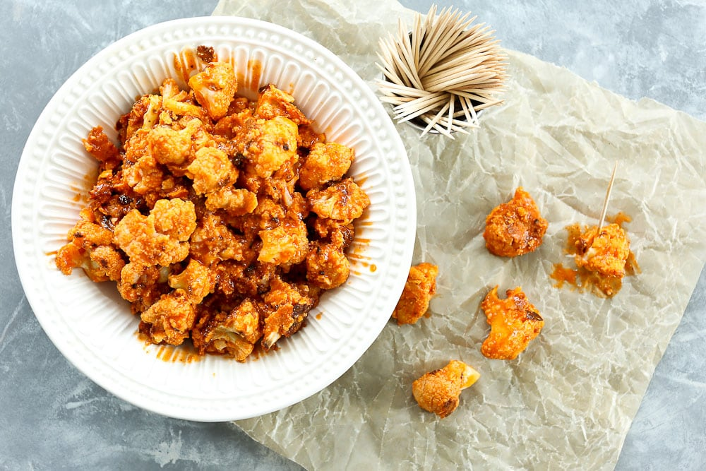 Buffalo Cauliflower Poppers Recipe--in a bowl with toothpicks