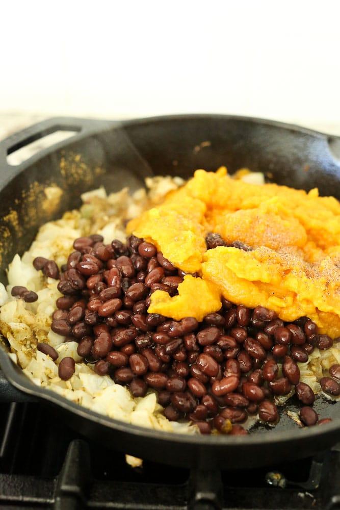Preparing the mixture for ButternutSquash Black Bean Enchiladas recipe--ingredients in pan