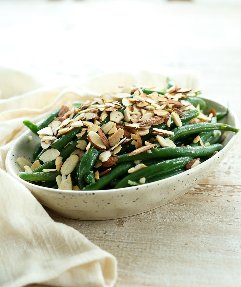 Side view of Garlic Butter Green Beans with Toasted Almonds Recipe