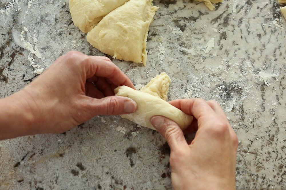 Perfect Bread Machine Dinner Rolls--rolling up the triangle into a crescent style roll
