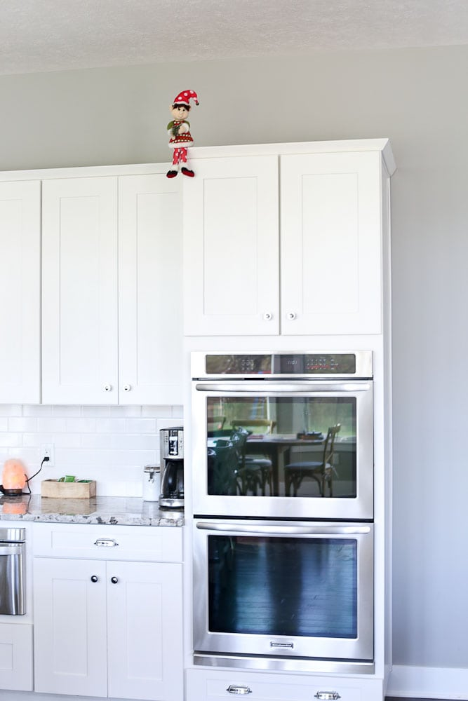 Dingle the original elf on the shelf-high up in the kitchen
