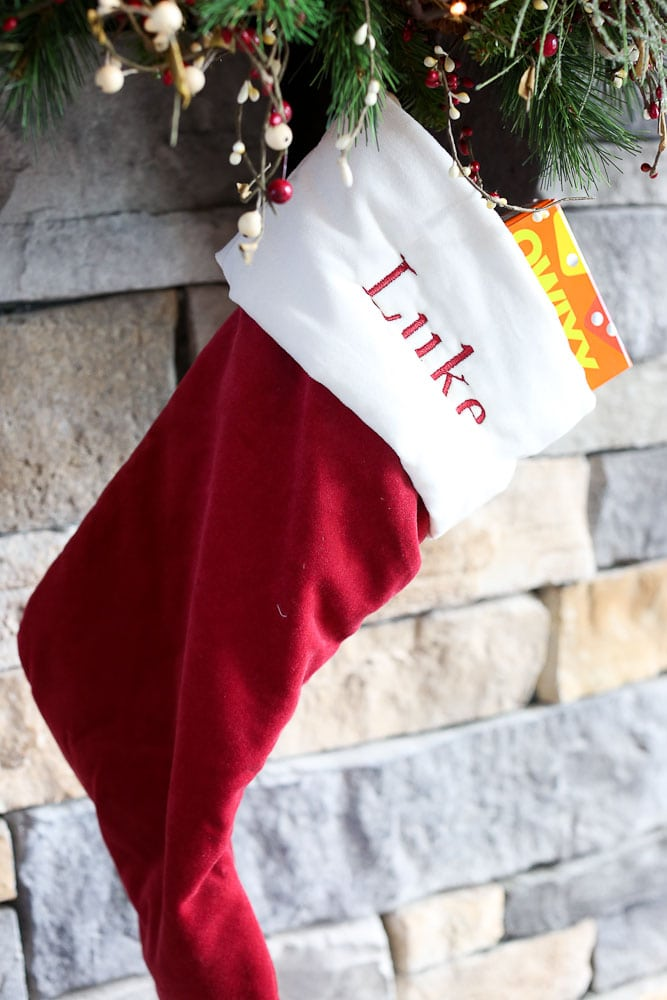 Dingle the original elf on the shelf--Luke's stocking with a gift in it
