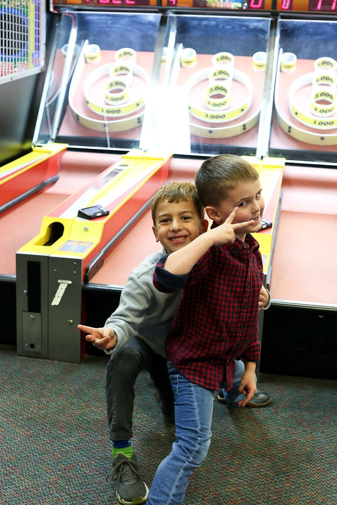 Luke's 6th Birthday Party at Chuck E Cheese's-posing with a friend