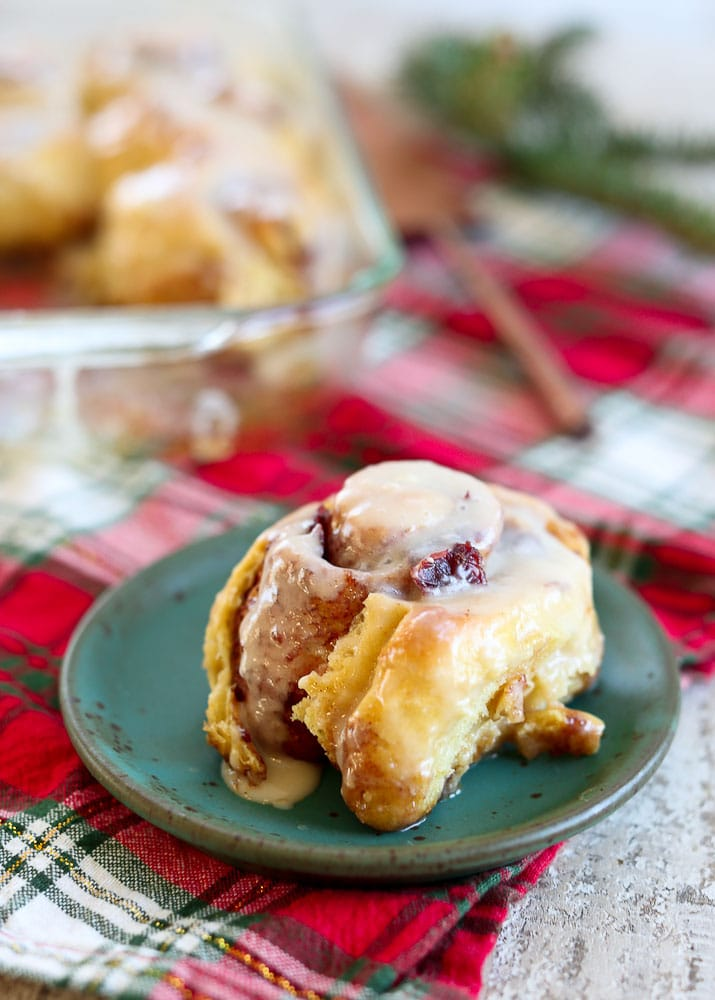 Overnight Cranberry Cinnamon Rolls-on a plate with the pan in the background