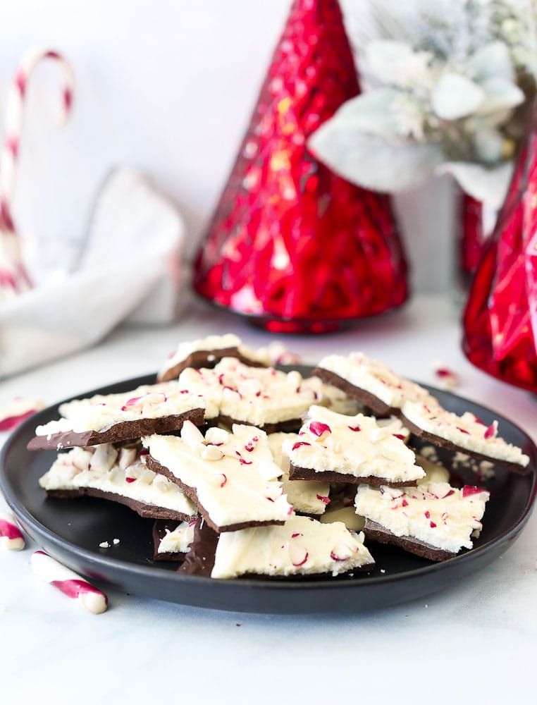 Homemade Peppermint Bark Recipe- on a plate with Christmas decorations