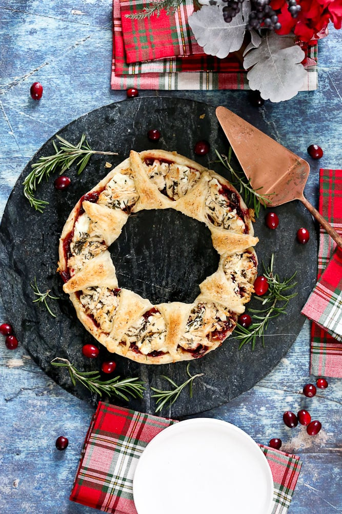 Puff Pastry Christmas WreathAppetizer with Christmas napkins on a serving plate