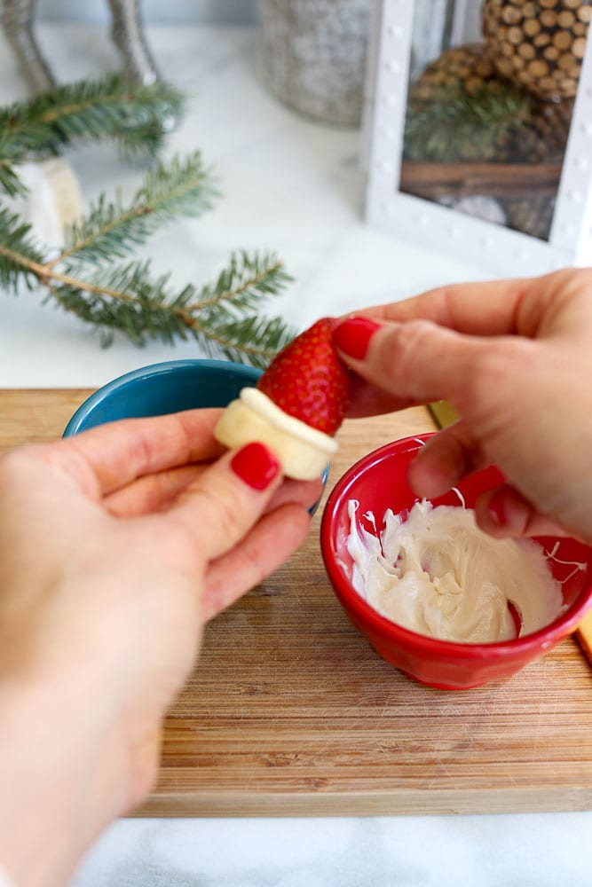 how to make Strawberry Banana Santa Hats - pressing the strawberry and banana together