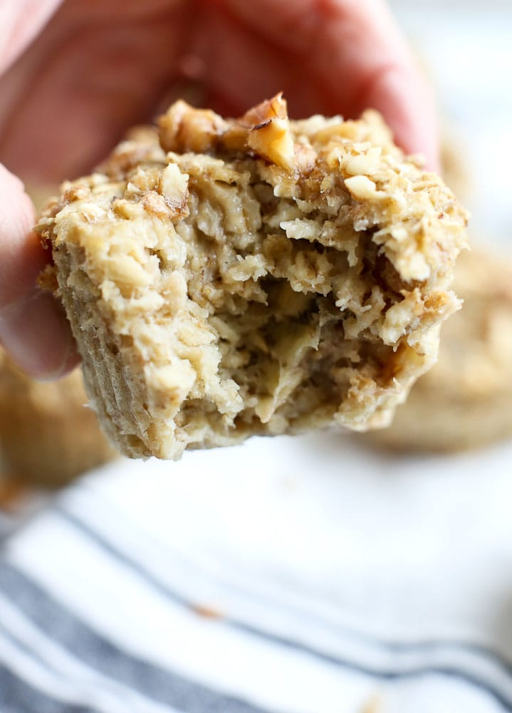 Banana Nut Oatmeal Muffins breakfast Cups recipe one muffin with a bite out of it