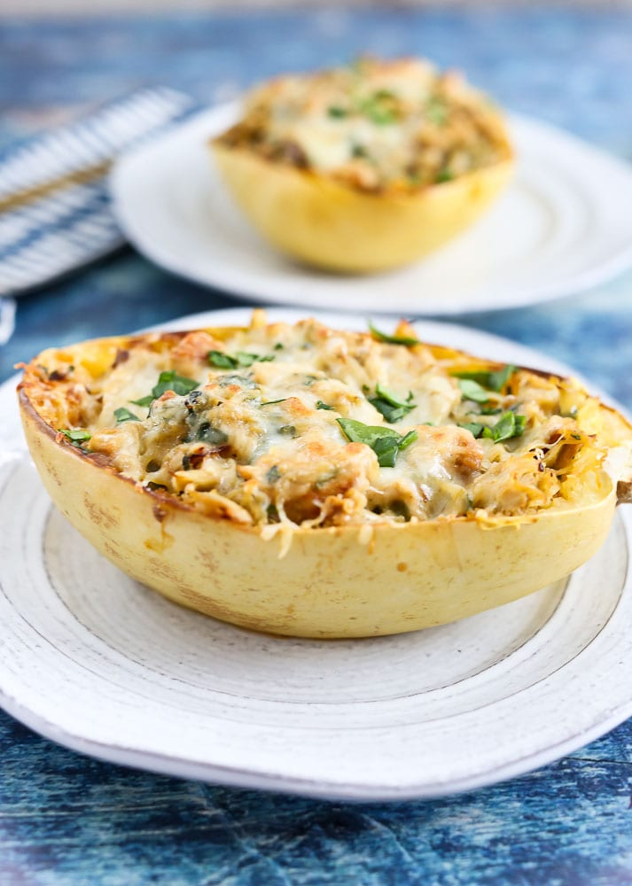 Spinach Artichoke Stuffed Spaghetti Squash with Chicken recipe on a plate