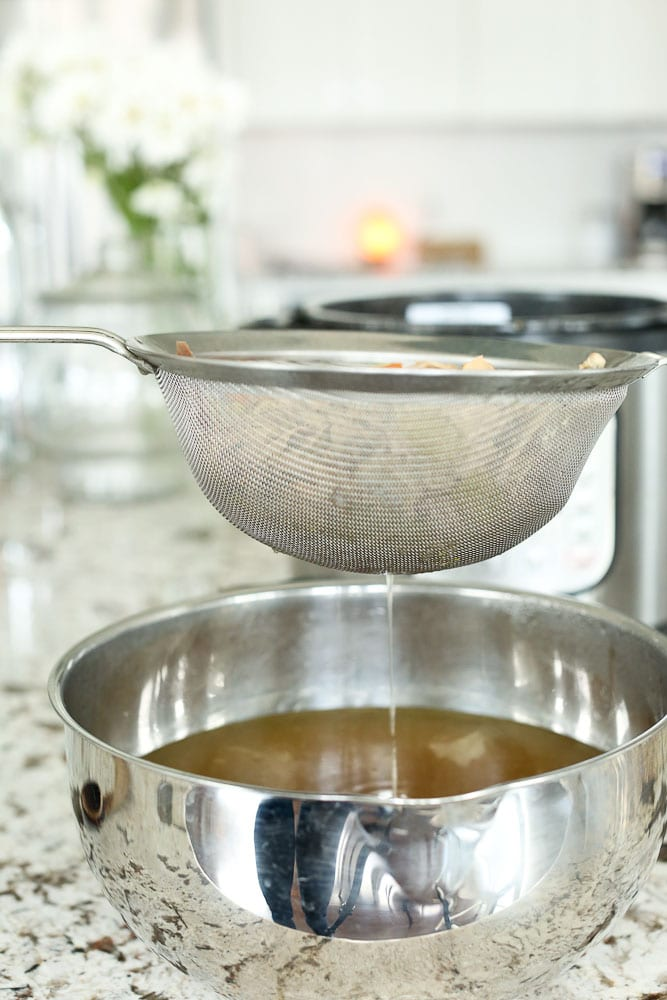 Instant Pot Bone Broth-straining the broth with a fine mesh strainer