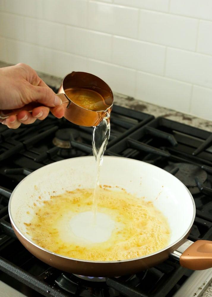 Shrimp Scampi Recipe-adding dry white wine to skillet