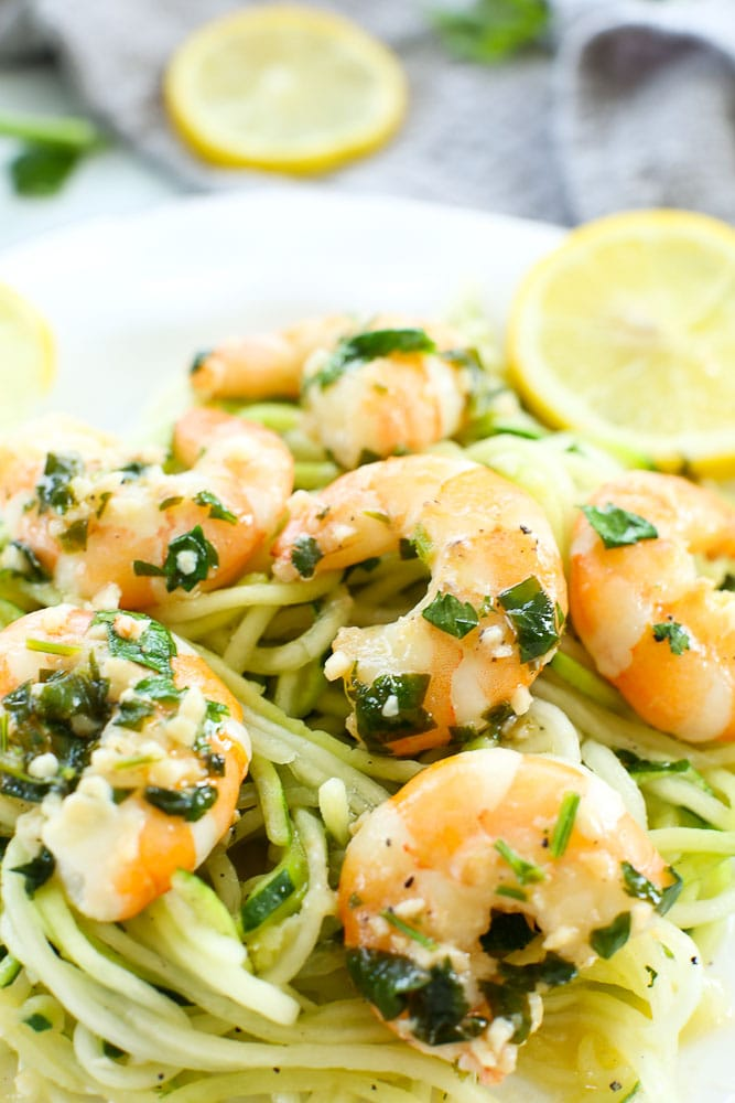 Shrimp Scampi recipe with zucchini noodles on a white plate
