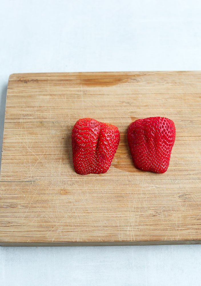 cut the strawberry in half length wise to make a strawberry heart