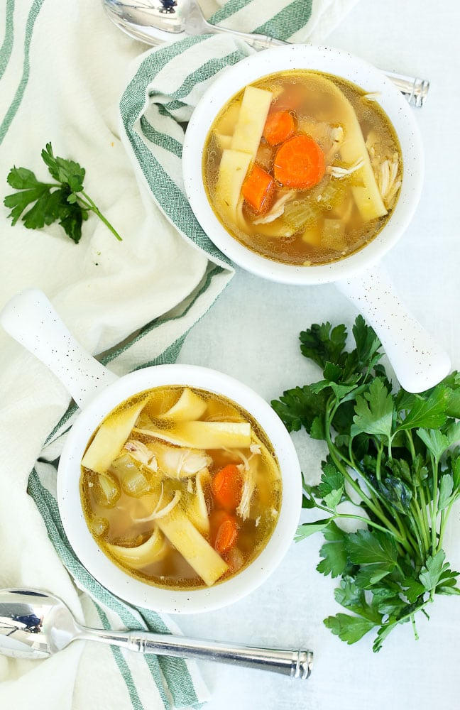 crockpot chicken noodle soup recipe in two bowls