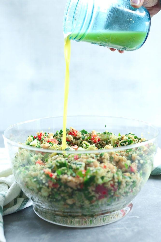 Quinoa Salad recipe pouring the dressing