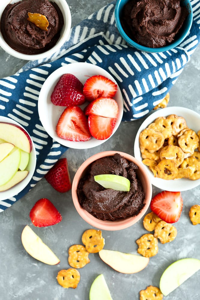 Brownie Batter Dessert Hummus recipe with strawberries apples and pretzels for dipping
