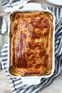 Dairy-free Chicken Pot Pie recipe whole pie in pan with browned puff pastry crust