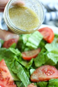 Homemade Italian Salad Dressing recipe pouring from the container